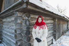 The Russian woman in  shawl warms hands near an Royalty Free Stock Photos