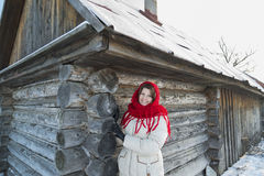 The Russian woman in  shawl warms hands near an Stock Photo