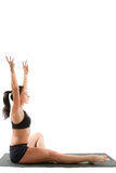 Russian woman in sports bra on yoga pose Stock Photos