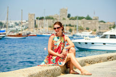 Russian woman on vacation in turkey. White woman sitting in front of the castle in bodrum, turkey Royalty Free Stock Photos