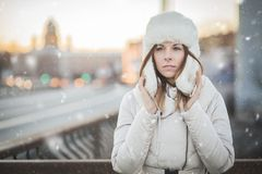 Russian woman in the winter city stock photography