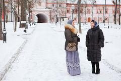 Russian women in winter clothes against church Stock Photos
