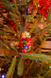 Russian wood doll. Beautiful russian wood doll in Christmas tree royalty free stock photography