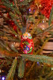 Russian wood doll. In Christmas tree royalty free stock images