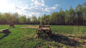 Russian wooden cart in a field stock video footage