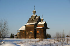 Russian wooden cathedral of XVIII century. A Russian countryside in snow Royalty Free Stock Photos