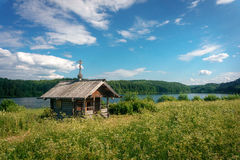 Russian wooden chapel in the forest Stock Image