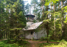Russian wooden chapel in the forest Stock Photo