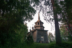 Russian wooden chapel in the forest Stock Images
