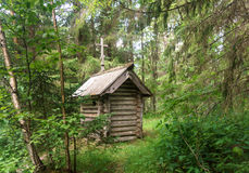 Russian wooden chapel in the forest Royalty Free Stock Photography