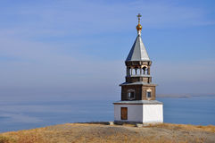 Russian wooden church. On river coast Royalty Free Stock Images