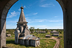 Russian wooden church. Old wooden church in Russian village, summer view Royalty Free Stock Image