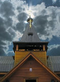 Russian wooden church. In the background of  sky clouds Royalty Free Stock Photos