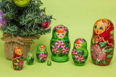 Russian wooden dolls around a Christmas tree Stock Photography