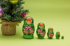 Russian wooden dolls and a Christmas tree Royalty Free Stock Photography