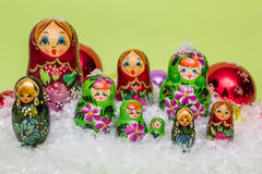 Russian wooden dolls with snow and Christmas balls Stock Image