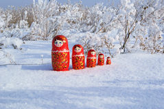 Russian wooden dolls on the snow Stock Image