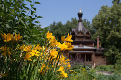 Russian wooden orthodox church. In the garden Royalty Free Stock Photos