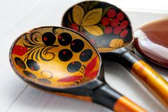 Russian wooden spoon on white background stock images