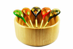 Russian wooden spoons on wooden bowl Royalty Free Stock Photography