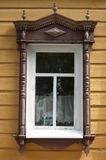 Russian wooden window in Tomsk, Russia.  Old house. Historic building. Stock Photography