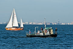 Russian yacht and a smaller vessel. Russian wooden mahony yacht and a smaller vessel for crusing with tourists outside Saint Petersburg in Russia royalty free stock image