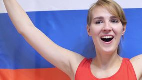 Russian Young Woman Celebrating while holding the Flag of Russia in Slow Motion. 4k , high quality stock video