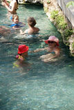 Russians and other tourists swim in the thermal pools Royalty Free Stock Images