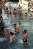 Russians and other tourists swim in the thermal pools Stock Photos