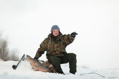 Russin Spearfishing with speargun shot a big fish under the ice. Of the river Volga near Volgograd area stock images