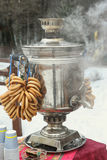 Russina samovar with bagels on winter background Royalty Free Stock Photo