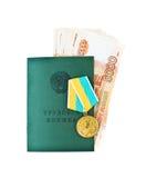 Russisch Arbeidsboek met medaille & x22; Voor grote job& x22; en bankbiljetten royalty-vrije stock foto's