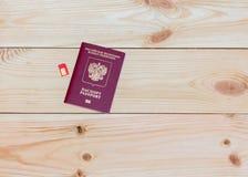Russisch paspoort en SIM-kaart Stock Afbeelding