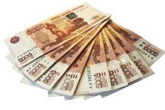 Russisch uit gewaaid geld, 5 duizendste nota's stock afbeeldingen