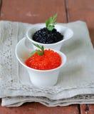 Russische delicatesse rode en zwarte kaviaar Royalty-vrije Stock Foto's