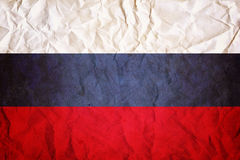 Russische Flagge, geknitterter Papierdesignhintergrund Lizenzfreies Stockfoto