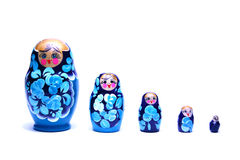 Russische het nestelen poppen (babushka) in lijn Royalty-vrije Stock Afbeeldingen