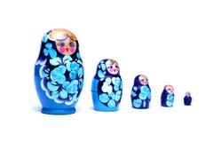 Russische het nestelen poppen (babushka) in lijn Stock Afbeelding