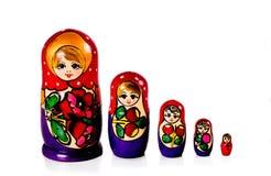 Russische matryoshka Puppen lokalisiert auf weißem Hintergrund Lizenzfreies Stockbild
