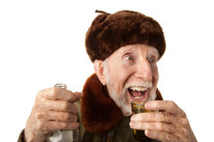 Russische Mens in Bont GLB met Wodka Stock Foto