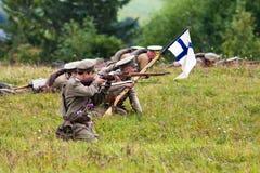 Russische militairen van de eerste wereldoorlog in het kruisvuur Stock Foto's