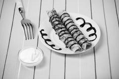 Russische Pfannkuchen - Blini mit Schokoladenbelag getont Lizenzfreie Stockbilder
