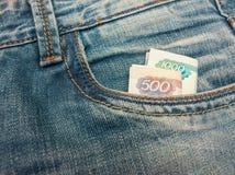 Russische roebels in jeans Royalty-vrije Stock Afbeeldingen