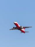 Russische rood-witte Superjet 100-95B Stock Foto