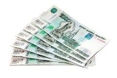 Russische Rubel (Banknoten 1000) auf einem weißen Hintergrund Lizenzfreie Stockbilder