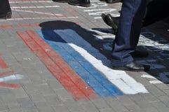 Russische vlag op de vergadering in de Oekraïne Stock Foto