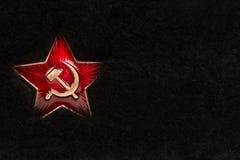 Russischer roter Stern mit Hammer und Sichel auf Pelz Lizenzfreie Stockbilder