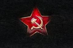 Russischer roter Stern mit Hammer und Sichel auf Pelz Stockfotografie