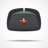 Russisches schwarzes Winterpelzhut ushanka mit rotem Stern Stockbild