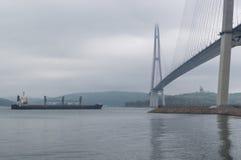 The Russky Bridge Russian Bridge. Eastern Bosphorus. Merchant spike. The Russky Bridge Russian Bridge. Eastern Bosphorus. Bridge to the Russian Russky island stock photos